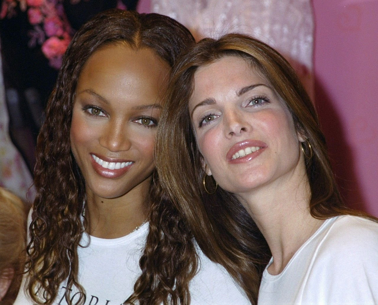 UNITED STATES - FEBRUARY 09: Supermodels Tyra Banks (left) and Stephanie Seymour put their heads together at the Victoria's Secret shop on Fifth Ave. They were on hand for the announcement that Victoria's Secret and Miramax will back a fashion show at the Cannes Film Festival on behalf of AIDS research. (Photo by Richard Corkery/NY Daily News Archive via Getty Images)